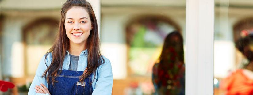 Woman smiling in front of business
